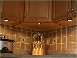 kitchen cabinet lighting tape lights secured to top of toe kick