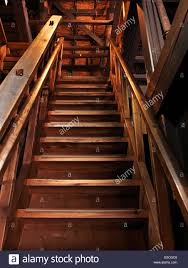 old wooden staircase leading upstairs in a historic japanese house