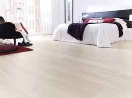 white oak laminate flooring for modern master bedroom design