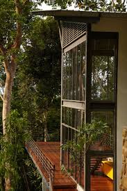 house windows design malaysia wood flooring terrace modern hillside home in janda baik