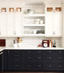 black kitchen cabinets with white subway tile backsplash black and white kitchen cabinets contemporary kitchen