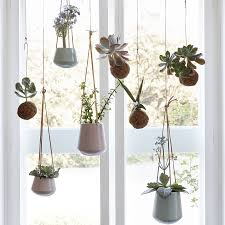 white hanging planter set of two hanging ceramic planters with leather straps by lilac