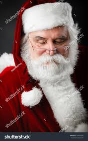 santa claus looking down over his stock photo 144645626 shutterstock