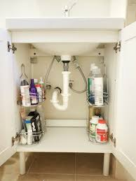 bathroom organization ideas for small bathrooms use a shower caddy as storage shelving a small sink