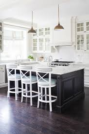gold pendant lights and white cabinets kitchen in the kitchen