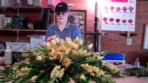 a peek inside the flower barn as i make a casket spray