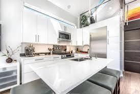white kitchen cabinets with quartz countertops quartz countertops with white cabinets stoneadd photo