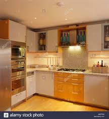 white kitchen wall cupboards recessed lighting below fitted wall cupboards in modern