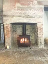 jotul f400 in blue black enamel in traditional fireplace our