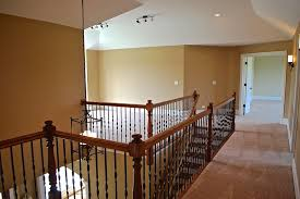 Wrought Iron And Wood Banisters Wrought Iron Spindles Staircase Mediterranean With Wood Railing