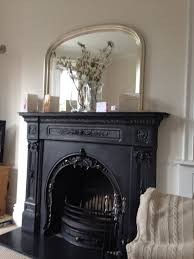 Beautiful Fireplaces by Beautiful Iron Fireplace With Over Mantle Mirror Above Abide