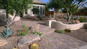front yard paver entry with pony wall surrounded by desert