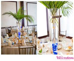 themed wedding centerpieces island themed wedding centerpieces vases with palm leaves