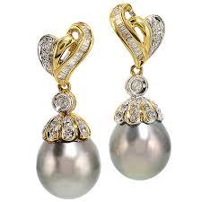 yellow gold earrings pearl and diamond dangling earrings in 18 kt yellow gold