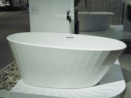 furniture home corals stone under stand alone bathtub with kohler corals stone under stand alone bathtub with kohler faucet in modern home bathroom design idea systems free standing floors tiling devonshire one piece diy
