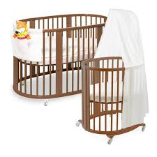 Baby Sleeper In Bed 16 Beautiful Oval U0026 Round Baby Cribs For Unique Nursery Decor