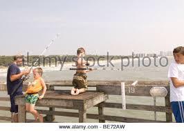 Cape Cod Kids Fishing - family kids fishing from shore of lake boy stock photo