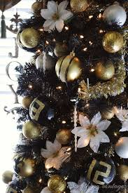 diy ornaments in black white and gold via inspirationcooperative