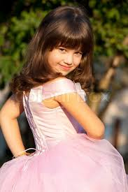 Sunny small cute princess is smiling  Stock Photo  Colourbox