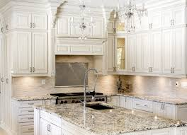glamorous crystal chandelier hung above kitchen island installed