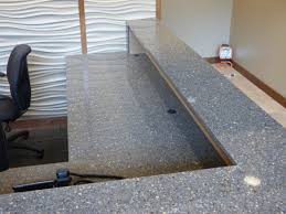Concrete Reception Desk by Custom Built Commercial Cabinetry Creative Surfaces