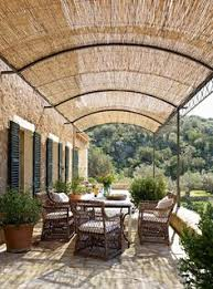 Outdoor Bamboo Shades For Patio by Roll Up Venetian Blinds Create Adjustable Shade On A Sun Drenched