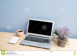 office desk with laptop black coffee notepad paper lavender