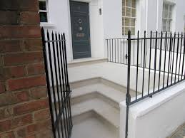chelsea front entrance and basement portland stone steps in london