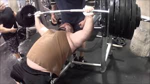 watch some heavy bench press action