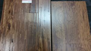 pros and cons of laminate flooring versus hardwood free expert