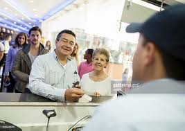 couple buying food at the movies stock photo getty images