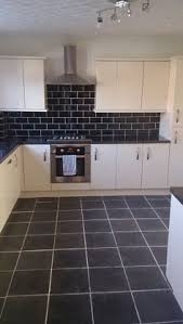 gloss kitchen tile ideas image result for black worktops white tiles kitchen ideas and