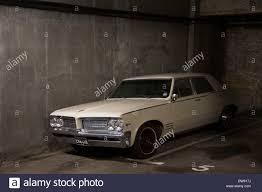 vintage pontiac v8 326 car in an underground garage american stock photo vintage pontiac v8 326 car in an underground garage american classic car london uk