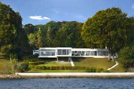 updated 1959 danish villa offers sleek style waterfront views for