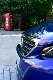 used peugeot dealers world u0027s smallest car dealership is a peugeot london phone box