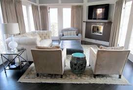 Cream And Grey Rug White Fabric Tufted Sofa And Shabby Mocha Chairs On The Rug