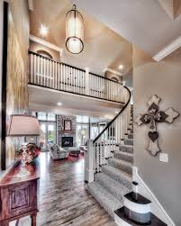 Open Floor Plan Interior Design by Entry Curved Staircase Open Floor Plan Pendant Lighting High