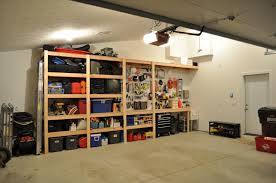 exterior garage design idea with hanging metal storage also wall