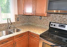 pictures of kitchen countertops and backsplashes brown glass tile santa cecilia countertop backsplash