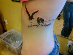 elegant feather tattoo with birds tattoo on rib photos pictures