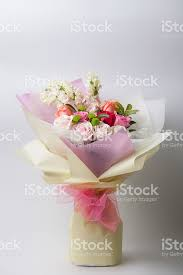 paper wrapped flowers flower bouquet wrapped with paper standing on white stock photo