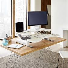 Platform For Standing Desk 10 Awesome Adjustable Desks To Get You Off Your At Work