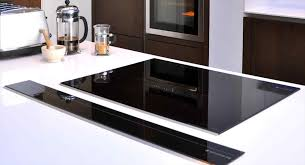 hood oven and natural cabinets kitchen island with hob hood