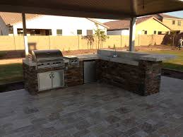 using outdoor kitchens are a great way to enjoy the beautiful