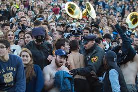 yale halloween costume students escorted out of stadium after saybrook strip