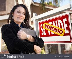 people at work female hispanic real estate agent and spanish sold