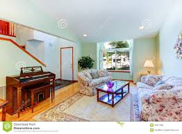 light mint living room with floral furniture and piano stock photo