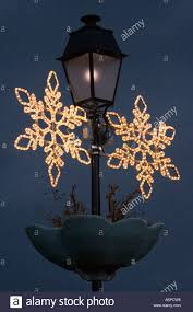 street lamp with christmas decoration in bize france stock photo