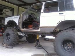 bagged nissan hardbody gmc jimmy on 38 superswampers pirate4x4 com 4x4 and off road forum