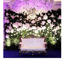 wedding backdrop garden paper flower cloud with hanging lights and a garden backdrop stage de